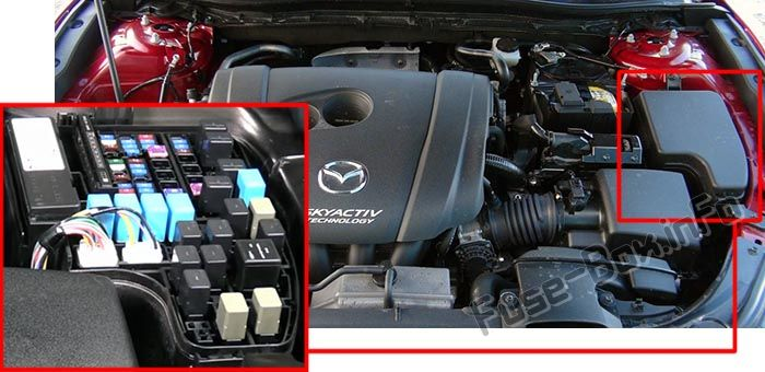 The location of the fuses in the engine compartment: Mazda 3 (2014-2019-...)