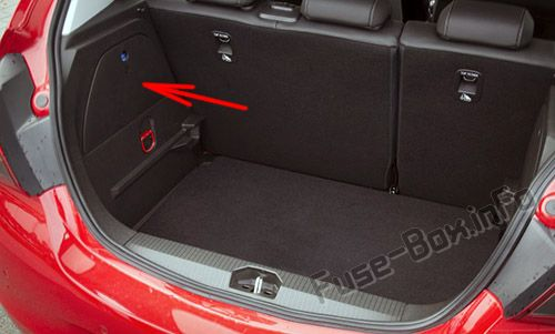 The location of the fuses in the trunk: Opel/Vauxhall Corsa D (2006-2014)
