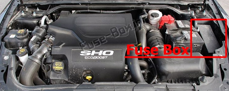 The location of the fuses in the engine compartment: Ford Taurus (2010-2012)