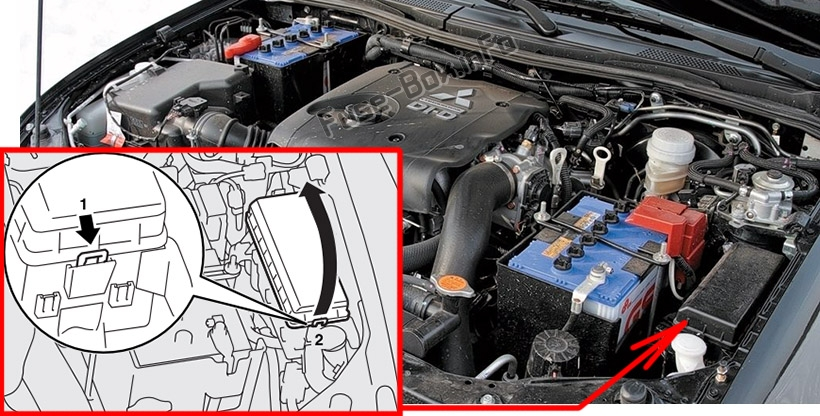 The location of the fuses in the engine compartment: Mitsubishi Pajero Sport (2008-2016)